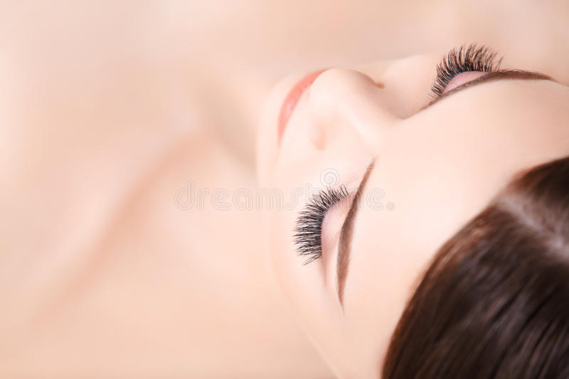 Woman Eye with Long Eyelashes. Eyelash Extension royalty free stock image