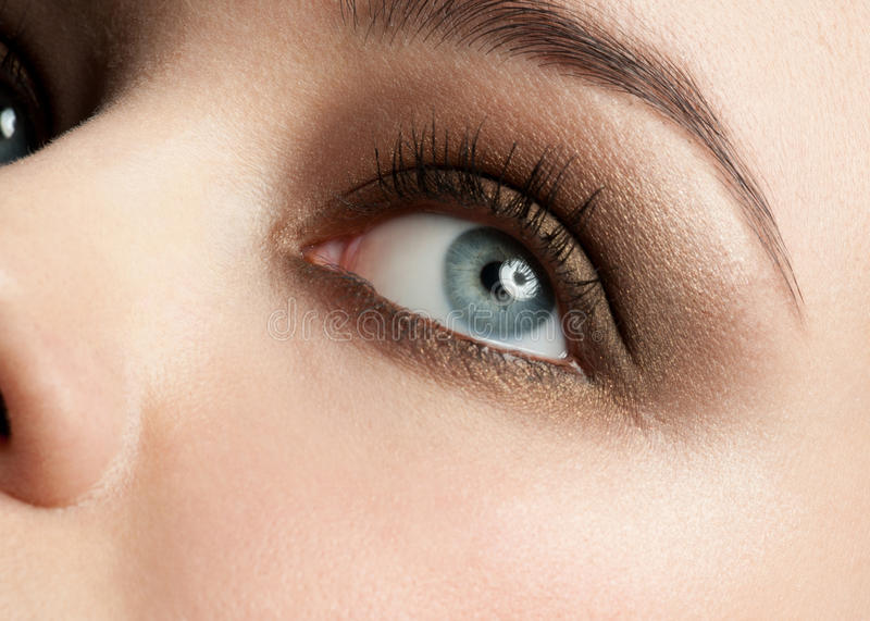 Woman eye with make-up. Close-up shot of beautiful female blue eye with bright fashion make-up stock photo