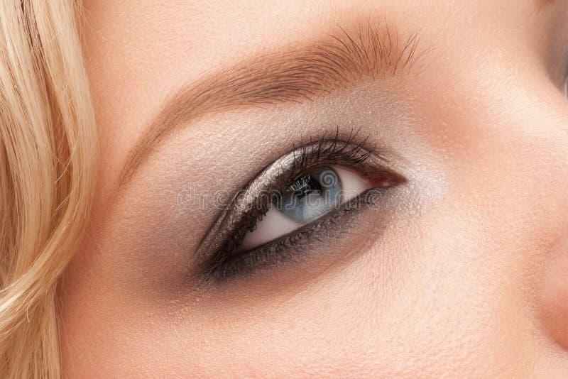 Woman eye with makeup stock photos
