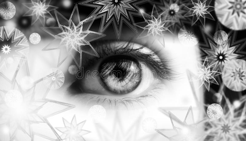 Woman eye with snowflakes royalty free stock images