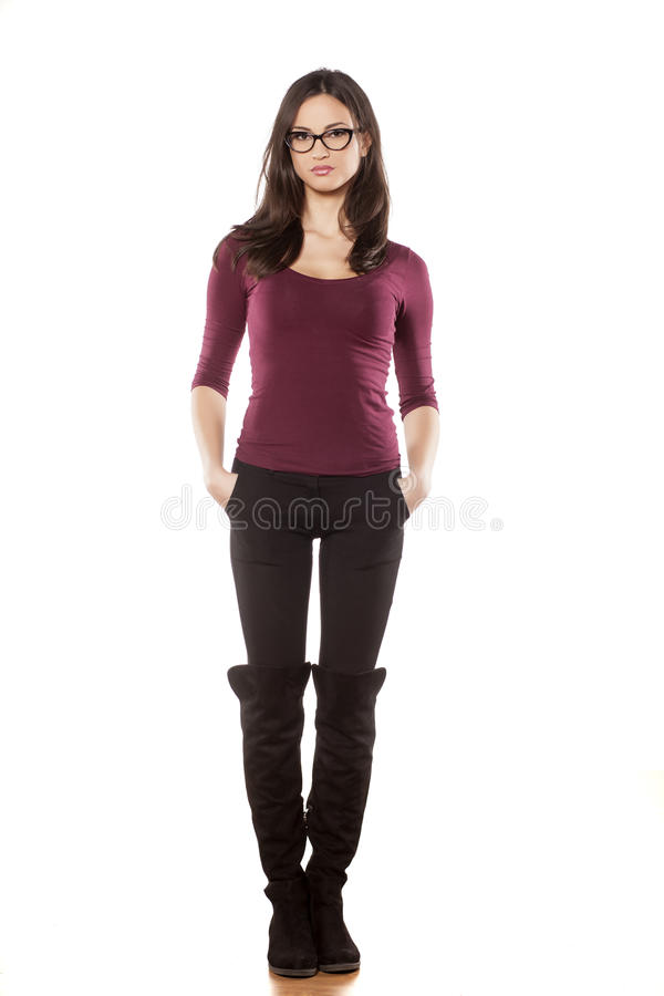 Woman with eyeglasses wearing boots royalty free stock photo