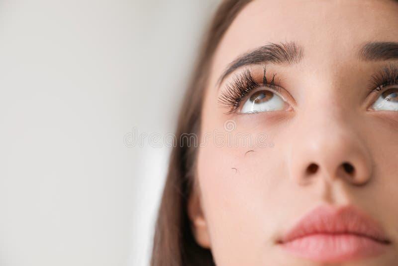 Woman with eyelash loss problem on light background, closeup. Young woman with eyelash loss problem on light background, closeup stock images