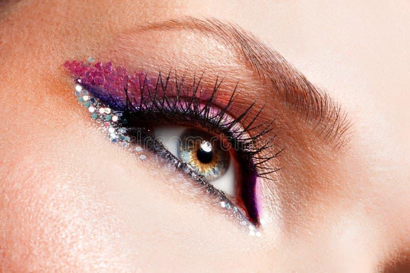 Woman eyes with beautiful fashion bright pink make-up. Closeup woman eyes with beautiful fashion bright pink make-up stock photos