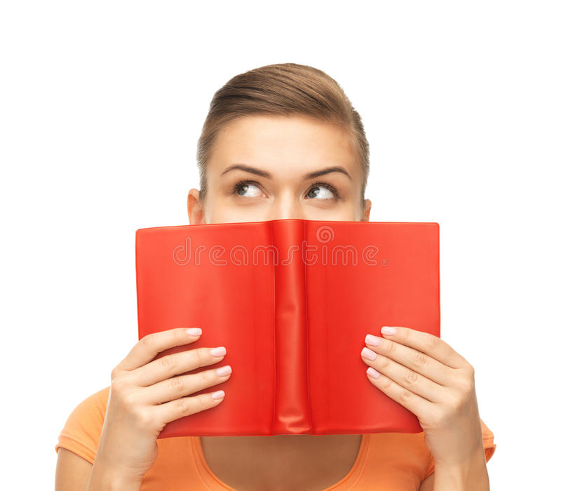 Woman eyes and hands holding red book royalty free stock photography
