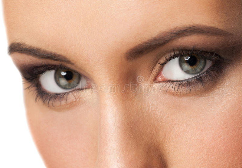 Woman eyes with makeup stock images