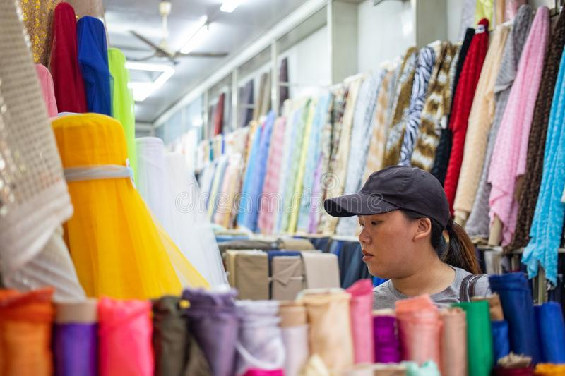 Woman in fabric shop royalty free stock images