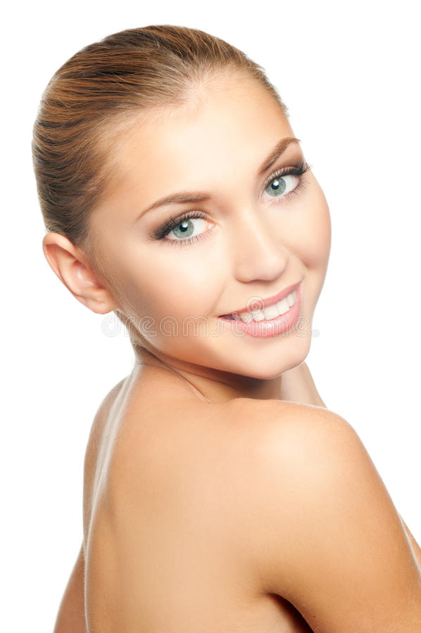 Woman face. Closeup beautiful woman face smiling on white background stock photo