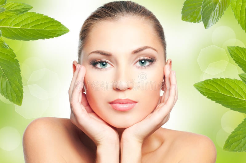 Woman face. Beautiful woman face on green nature background stock images