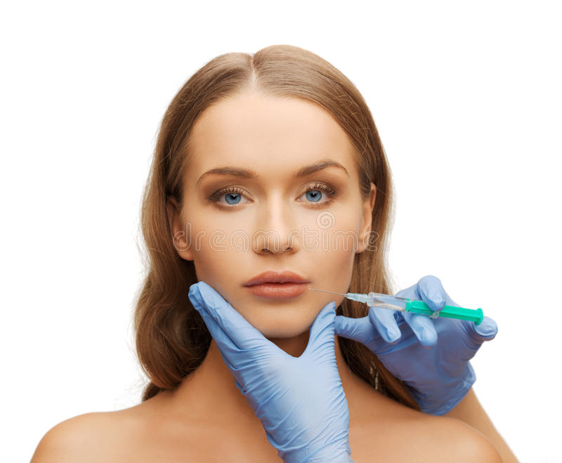 Download Woman Face And Beautician Hands With Syringe Stock Image - Image of beautiful, anti: 33505971