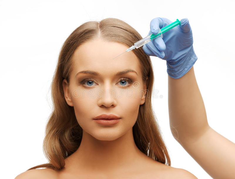 Download Woman Face And Beautician Hands With Syringe Stock Photo - Image: 33340086