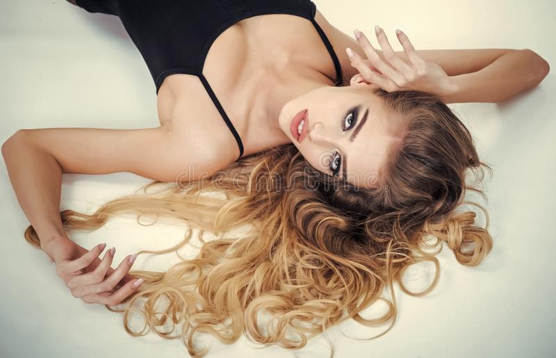 Woman face beauty. Fashion Model Girl Portrait with Long curly Hair stock image