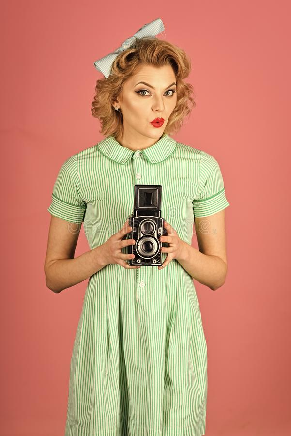 Woman face beauty. Beauty, fashion photography, vintage style. Sensual girl in pinup style, make photo. Retro woman hold photo camera. Family portrait, old stock images