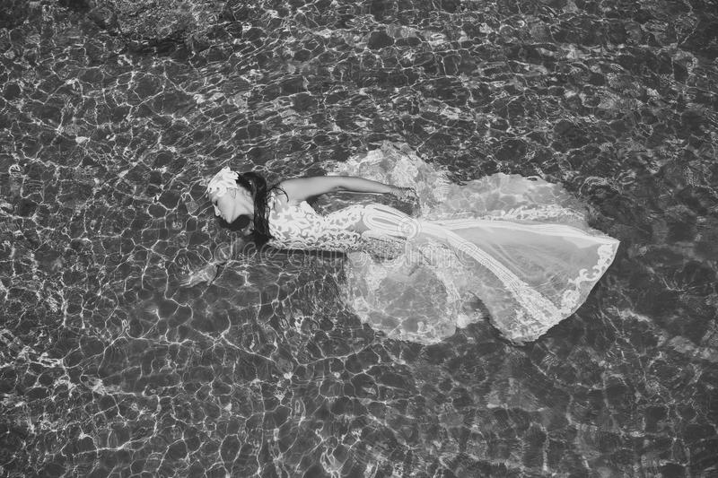 Woman face beauty. Girl lying in sea water royalty free stock photography