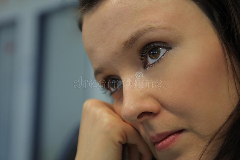 Woman face with brown eyes stock photography