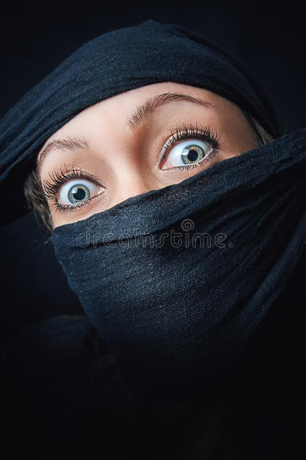 Woman face close up with only eyes visible royalty free stock photos