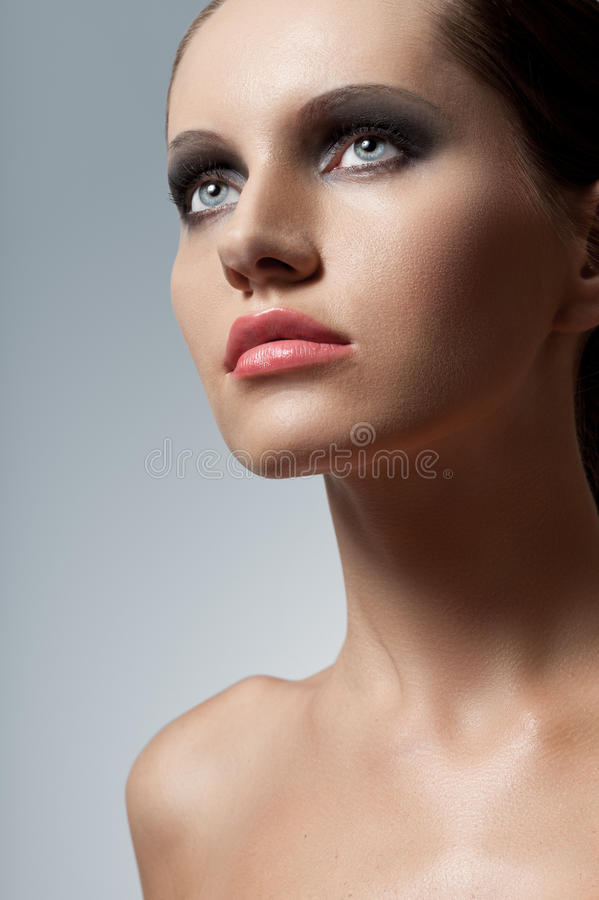 Woman face closeup portrait with smoky eyes stock images