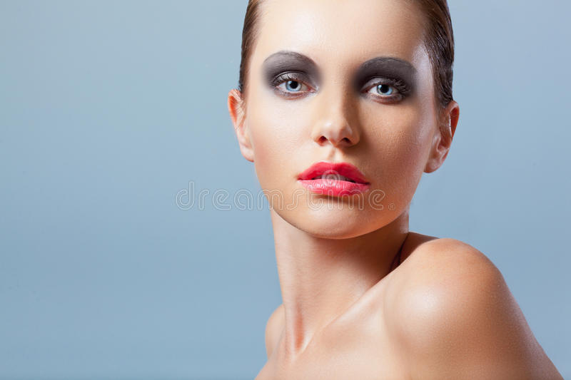 Woman face closeup portrait with smoky eyes stock photography