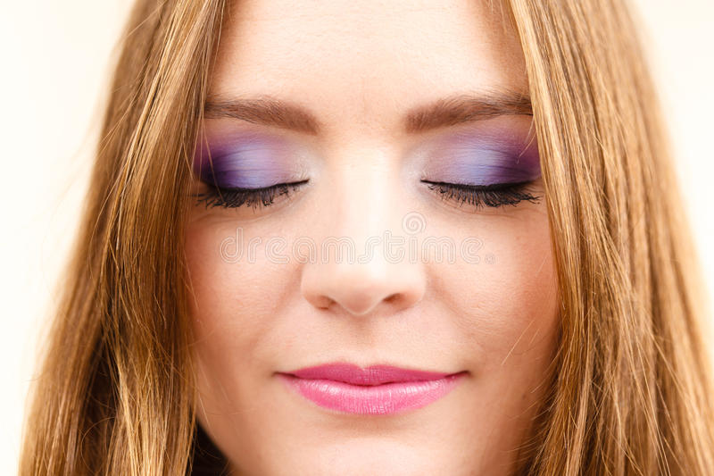 Woman face colorful eye makeup closed eyes closeup royalty free stock photos