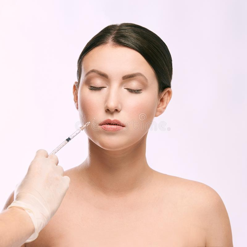 Woman face injection. salon cosmetology procedure. skin medical care. dermatology treatment. anti aging wrinkle lifting stock images