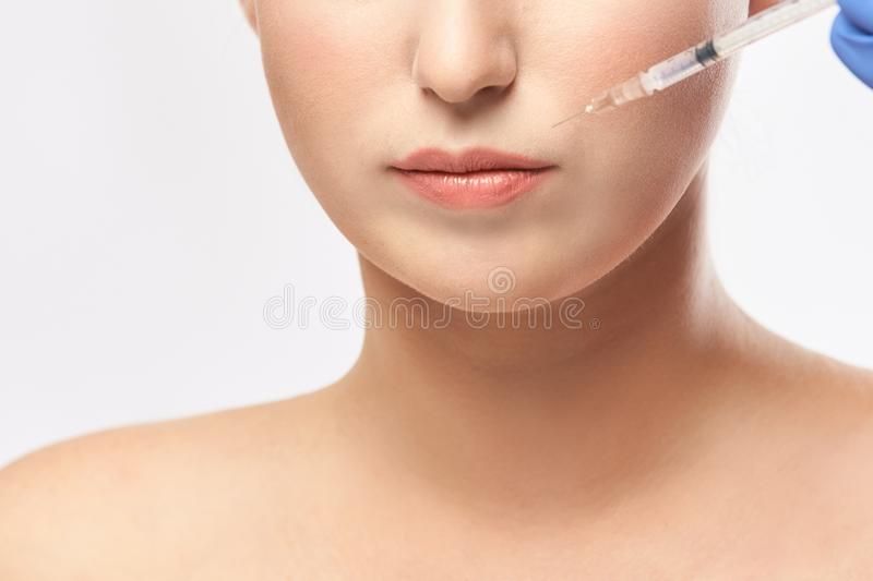 Woman face injection. salon cosmetology procedure. skin medical care. dermatology treatment. anti aging wrinkle lifting.  stock photo