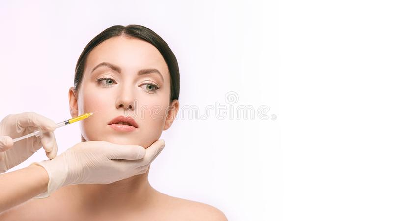 Woman face injection. salon cosmetology procedure. skin medical care. dermatology treatment. anti aging wrinkle lifting.  royalty free stock images