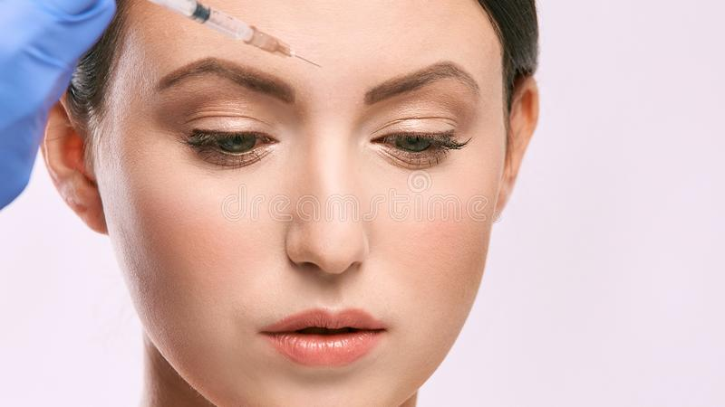 Woman face injection. salon cosmetology procedure. skin medical care. dermatology treatment. anti aging wrinkle lifting.  royalty free stock photos