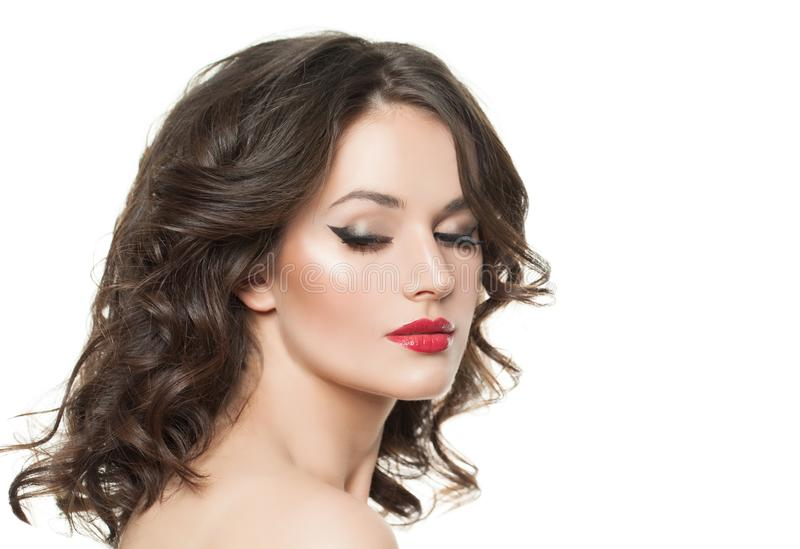 Woman face isolated. Pretty model with makeup and curly hair isolated on white.  stock images