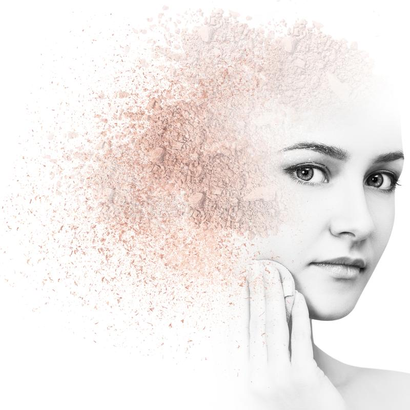 Woman face made from crumbly powder. Woman face made from crumbly powder isolated on white background stock photography