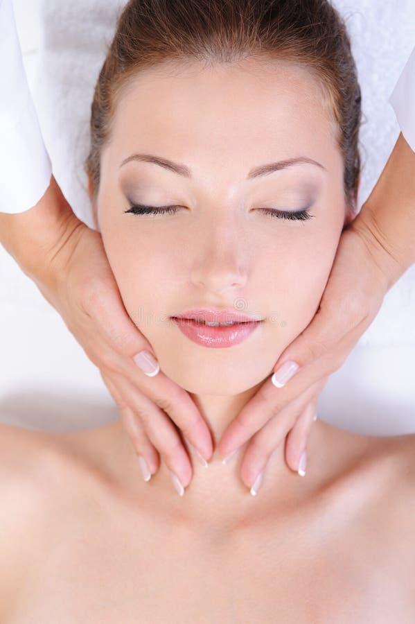 Woman face massage stock image