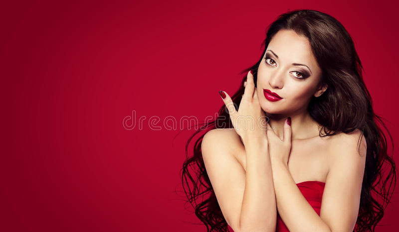 Woman Face on Red, Fashion Model Makeup Beauty Portrait royalty free stock images