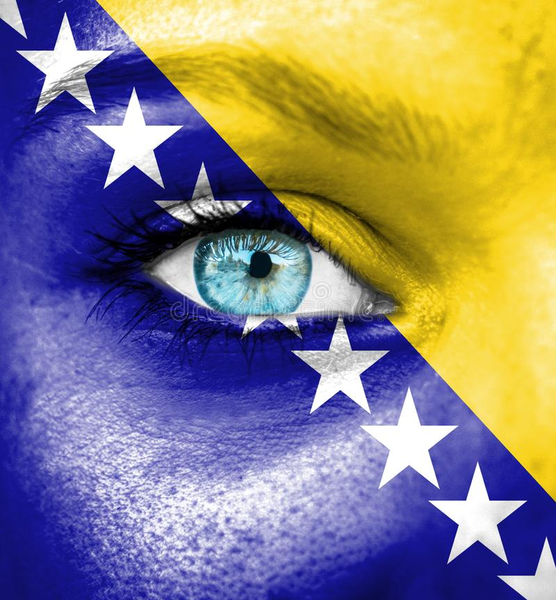 Woman face painted with flag of Bosnia and Herzegovina stock photos