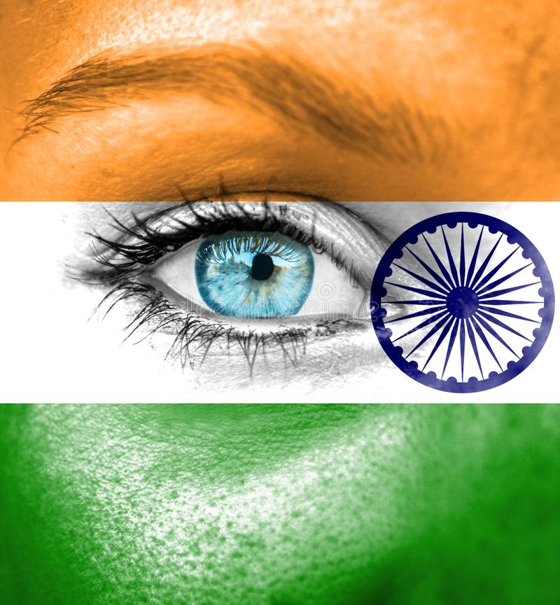 Woman face painted with flag of India stock images