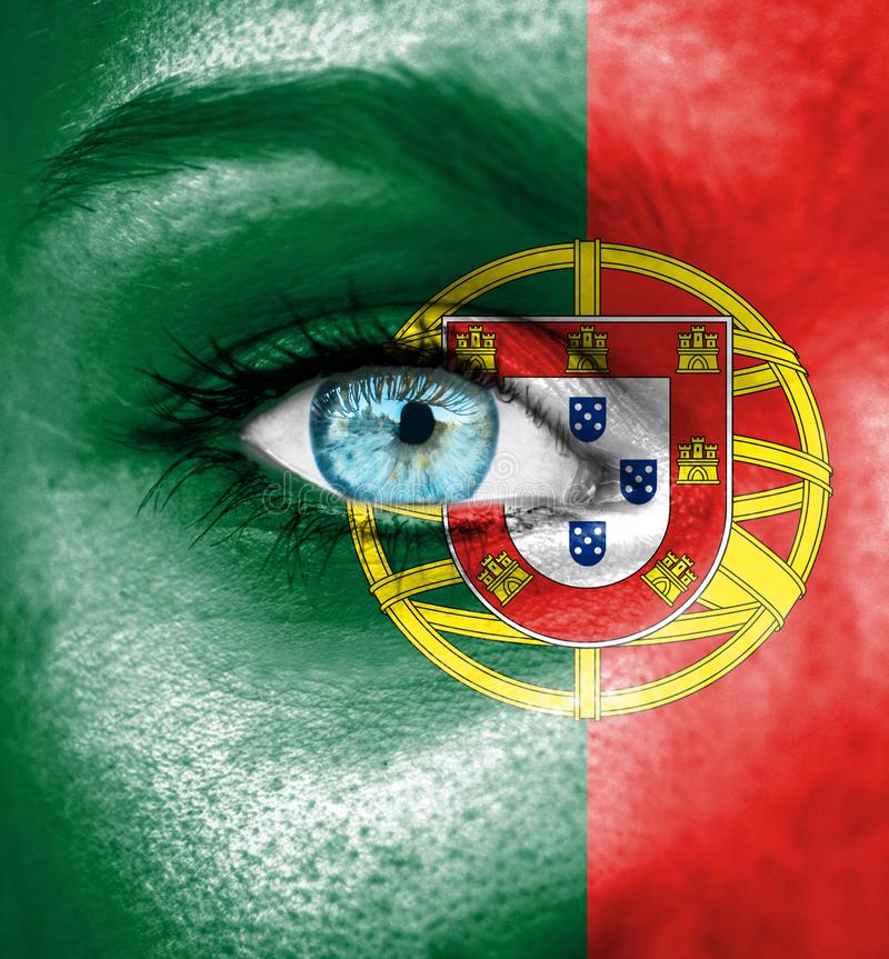 Woman face painted with flag of Portugal stock images