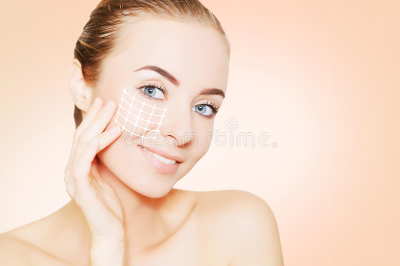 Woman face portrait with lifting marks. Renovating skin concpet. woman face portrait with lifting marks stock photo