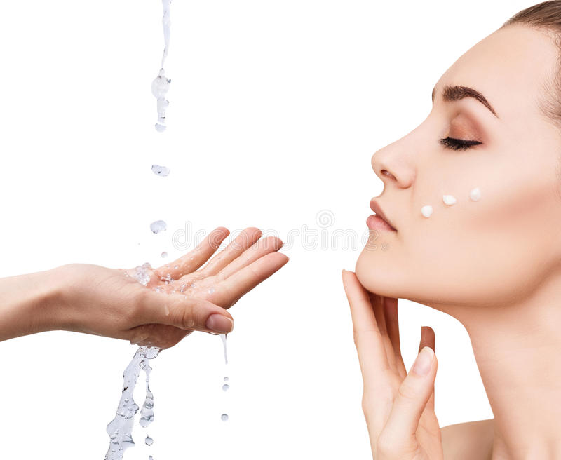 Woman face and pouring water in hand. royalty free stock photos