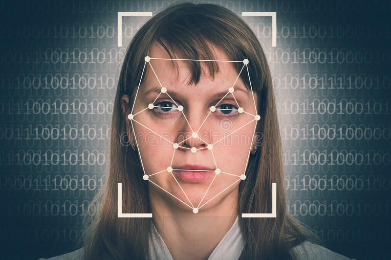 Woman face recognition - biometric verification concept stock photos