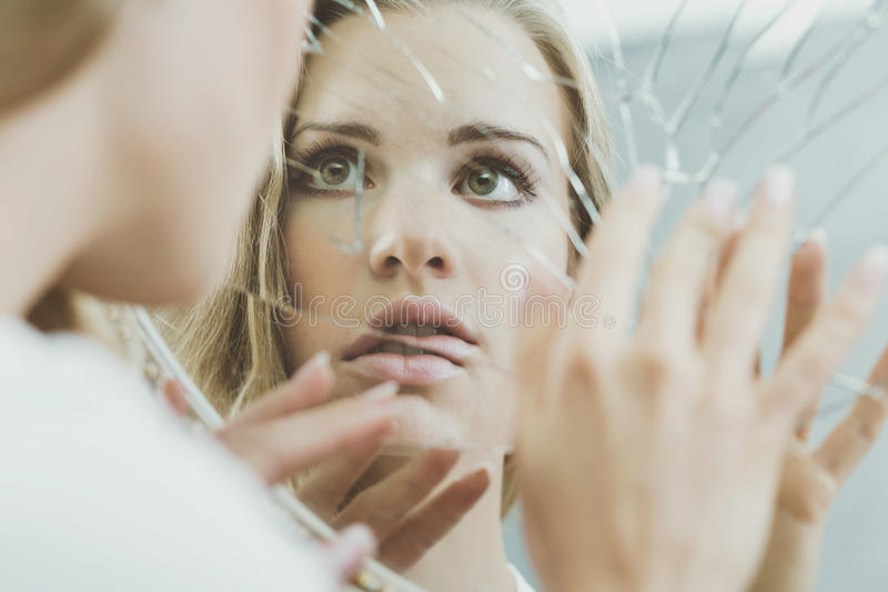 Woman face reflected in mirror royalty free stock images