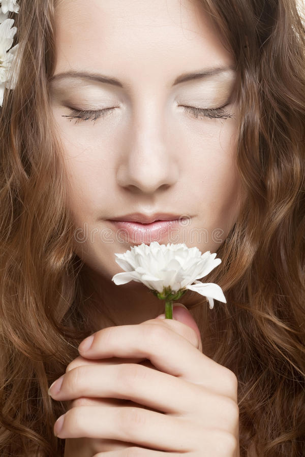 Woman face with white flowers. Attractive young woman face with white flowers stock photography