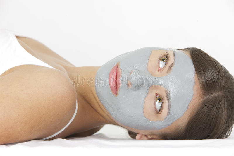 Woman with facial mask stock photography