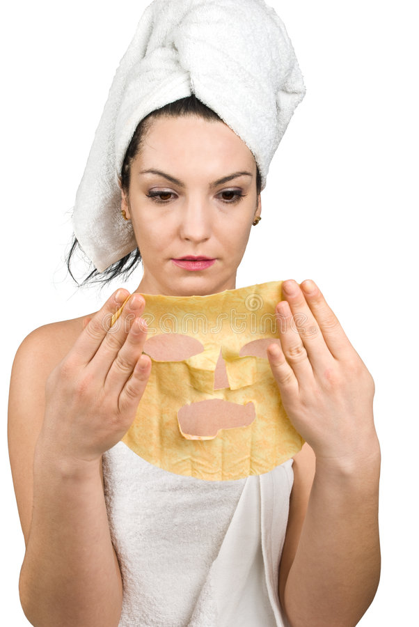 Woman with facial mask. Young natural woman holding a facial paper citrus mask in her hands and she want to put on face or to peel off isolated on white royalty free stock photos