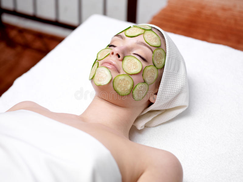 Download Woman With Facial Mask Of Cucumber Stock Photo - Image: 19069964
