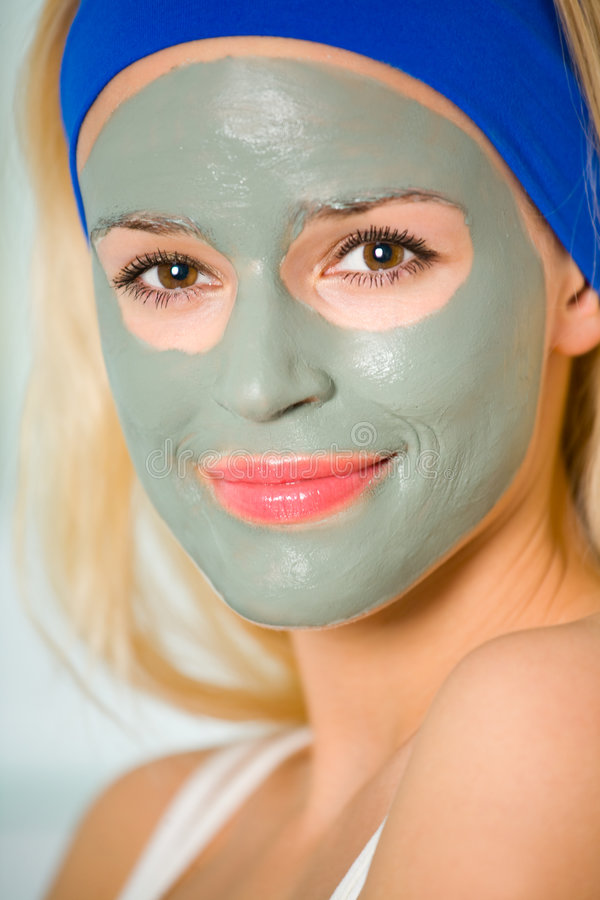 Woman with facial masque. Young woman with organic facial masque royalty free stock image