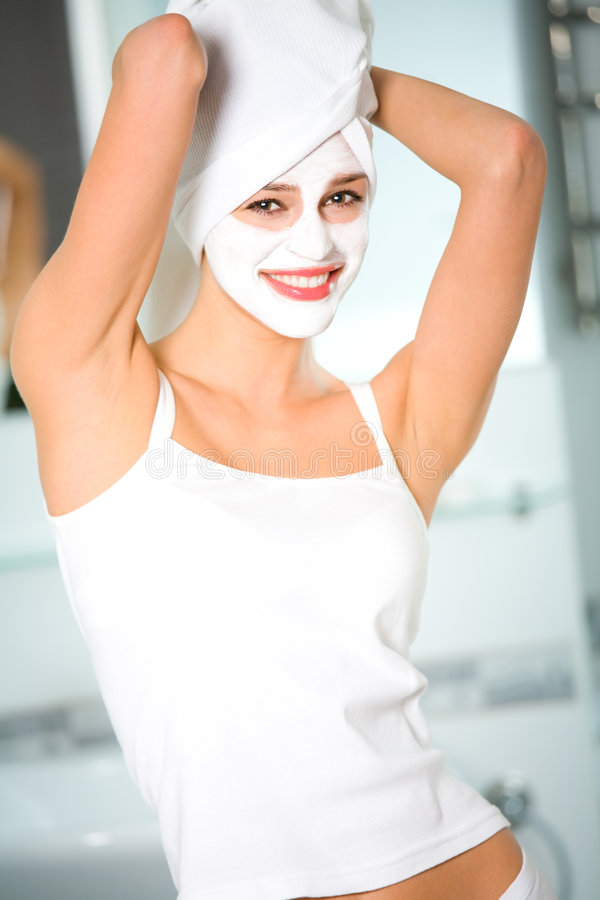 Woman with facial masque. Young woman with organic facial masque royalty free stock photography