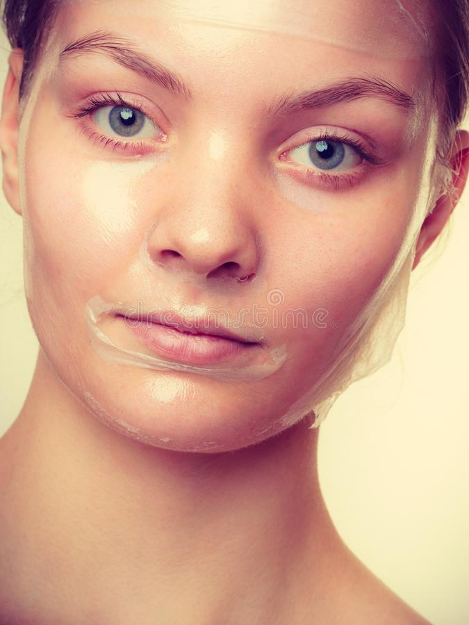 Woman in facial peel off mask. Young woman in facial peel off mask. Peeling. Beauty and skin care. Studio shot toned image royalty free stock photos
