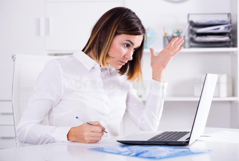 Woman facing challenge stock photography