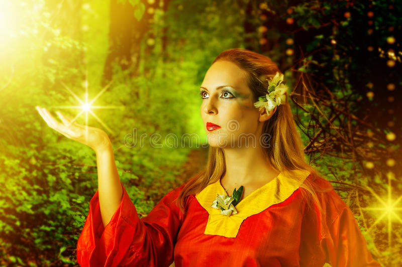 Woman fairy in summer magic forest royalty free stock image