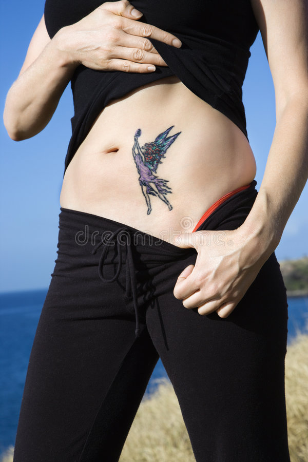 Woman With Fairy Tattoo. Royalty Free Stock Image