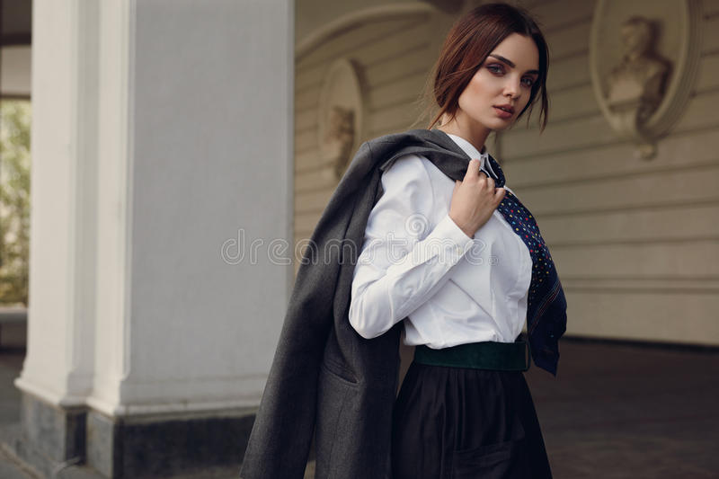 Woman Fall Fashion. Beautiful Model In Fashion Clothes In Street royalty free stock photo