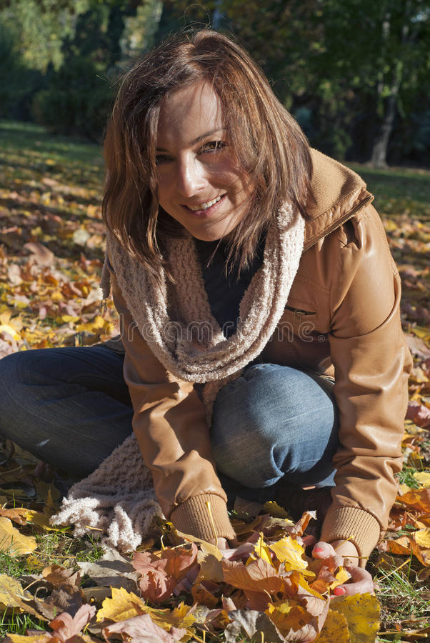 Woman With Fall Vibrant Leaves Stock Photos