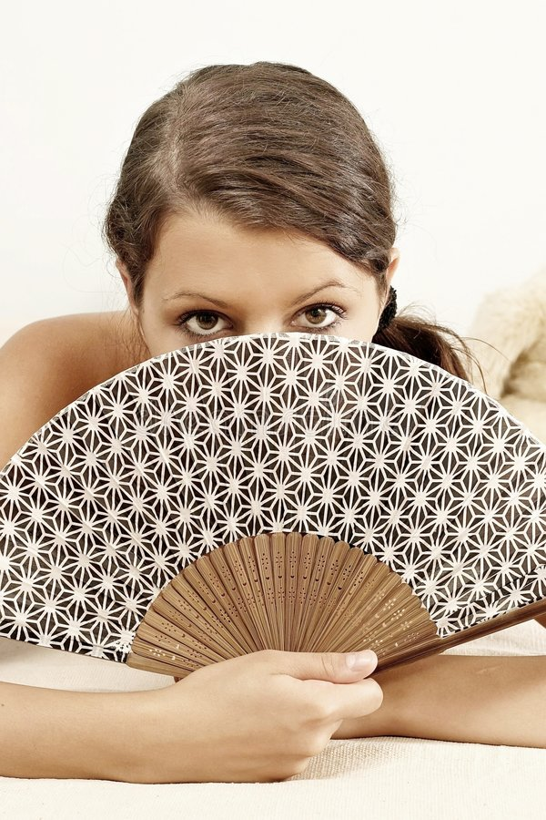 Woman with a fan. Girl, young woman with a fan stock photography